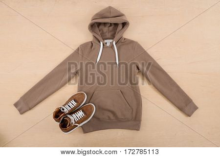 Mans shoes and clothes shirt on wood background