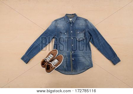 Jean shirt with shoes –wooden background