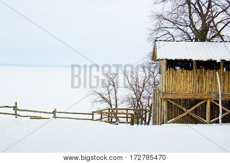 winter snow wooden structure on the banks of the river the ice on the river