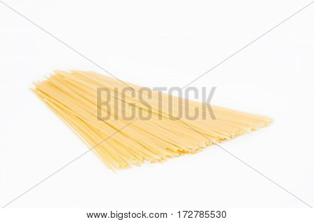 Small pile of spaghetti isolated on white background