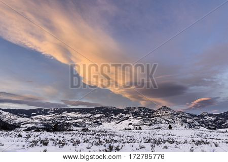 Colorful Sky at Sunset Over Snow Covered Valley