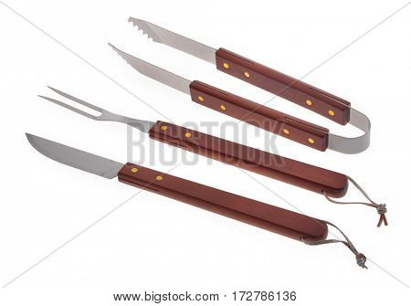 Set of used barbecue tools isolated over white background