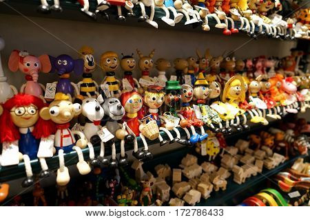 PRAGUE, CZECH REPUBLIK - OCTOBER 17, 2016: Wooden dolls in a souvenir shop in Prague. In the Old Town of Prague there are many souvenir shops for tourists from all over the world.