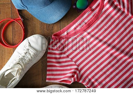 Stylish clothing on wooden floor