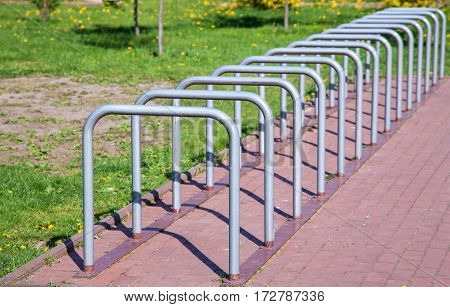 parking space for bicycles outside on sunny summer day
