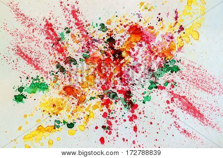 Abstract watercolor vivid colorful background painting with spray, spots, splashes. Hand drawn on paper grain texture. For modern pattern, wallpaper, banner design