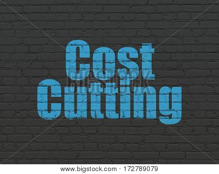 Business concept: Painted blue text Cost Cutting on Black Brick wall background
