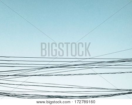 Bright blue sky and the black wire lined.