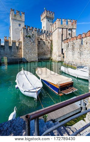 Sirmione, province of Brescia, Lombardy, northern Italy - 15th August 2016: view to medieval castle Scaliger on lake Lago di Garda