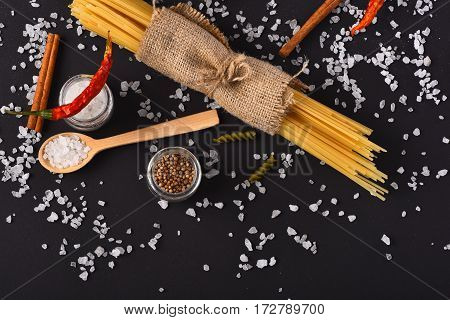 Bunch Of Spaghetti With Spoon And Salt Crystals
