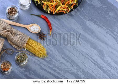 Bunch Of Spaghetti In Sackcloth And Fusilli In Bowl