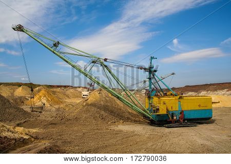 Walking excavator - dragline ESH 13/50 (bucket capacity of 13 cubic meters boom length of 50 meters). Kaolin quarry near the town of Pology in the Zaporizhya region of Ukraine. September 2005
