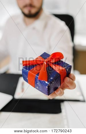 Business man in white shirt is preparing a gift for women employees