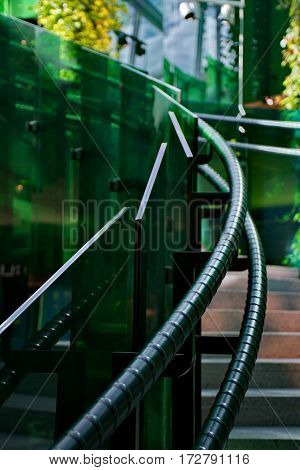 Stairway with green glass going way up