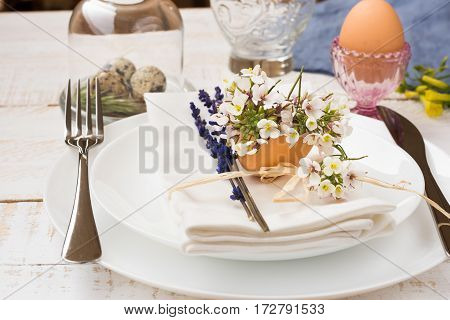 Easter table setting white plates napkin flowers in eggshell lavender quail eggs minimalistic outdoors kinfolk authentic