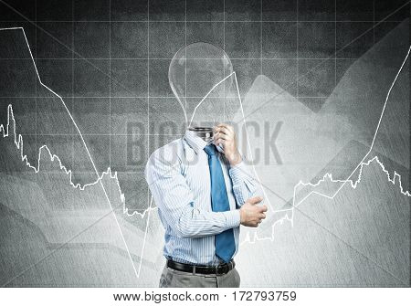 Pensive businessman with lightbulb head on concrete background.