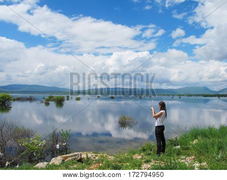 tourist taking pictures at a breathtaking lake in Croatia