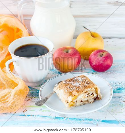 Strudel With Apples, A Cup Of Black Coffee And Milk Jug