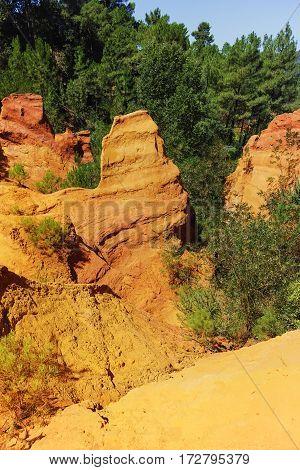 Oragne ochre picturesque hills. Village Roussillon, Provence France. Preserve natural dye production - ocher.