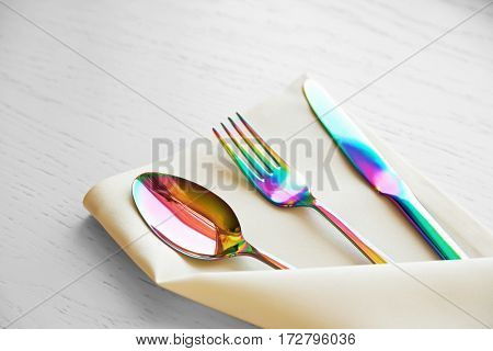 Chrome fork, spoon and knife on linen napkin