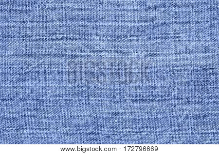 Homespun hemp cloth. Close-up of texture fabric cloth textile background. Homespun hemp fabric material. Homespun hemp canvas. Natural authentic cloth. Blue color