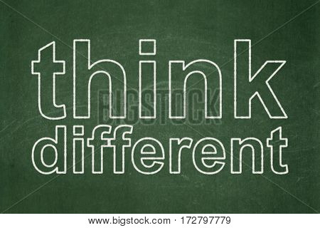 Studying concept: text Think Different on Green chalkboard background