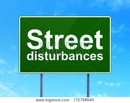 Political concept: Street Disturbances on green road highway sign, clear blue sky background, 3D rendering