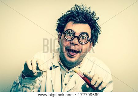 Crazy Scientist Performing Experiments In Laboratory