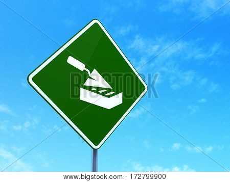 Constructing concept: Brick Wall on green road highway sign, clear blue sky background, 3D rendering