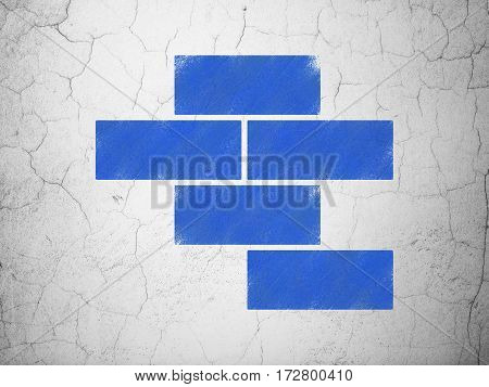Construction concept: Blue Bricks on textured concrete wall background