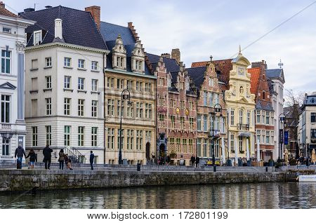 GHENT, BELGIUM - JANUARY 28, 2017: Colorful houses on the riverside in Ghent Flanders Belgium