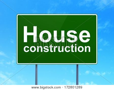 Building construction concept: House Construction on green road highway sign, clear blue sky background, 3D rendering