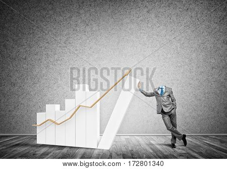 Headless businessman leaning on growing bar graph