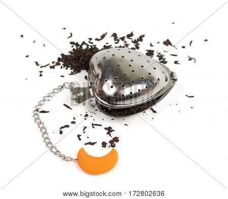 Closing tea strainer with black tea. Isolated on white