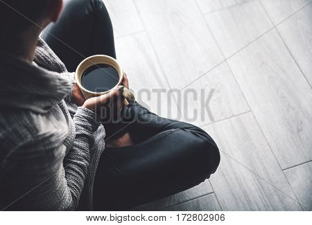 Close-up of a woman's hand holding a cup of hot coffee. fashion leisure