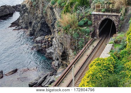Railroad tunnel near the coast of Mediterranean sea at Cinque Terre national park, Italy