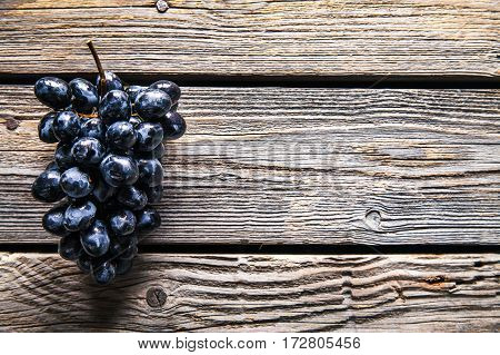 Grapes on a old wooden table. fruit. Food