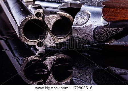 Shotgun Breech Detail On Wet Surface