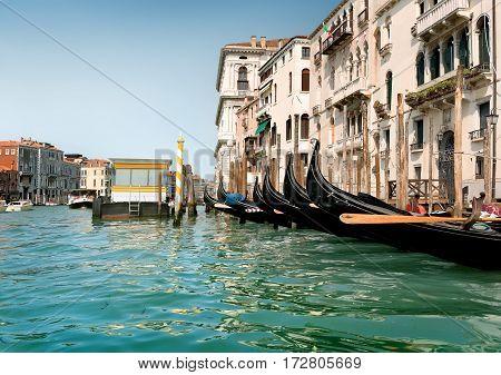 Black gondolas near vaporetto stop in Venice