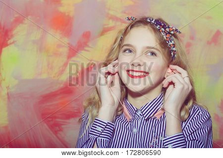 Cheerful Pretty Girl Listens To Music With Earphones