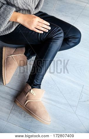 The girl with a nice manicure gray dress ugg boots. Shoes fashion style modern