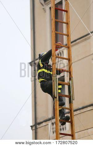 Fireman Climbs Above The Staircase