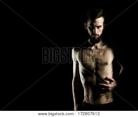 Slim Bearded Man With Thin Bare Torso Isolated On Black