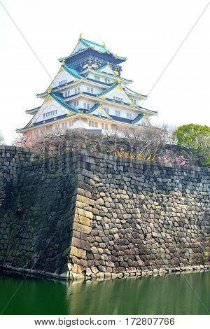 Osaka castle tower and stone moat in Osaka Japan