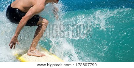 A surfer navigates his way while riding a nice wave in the ocean