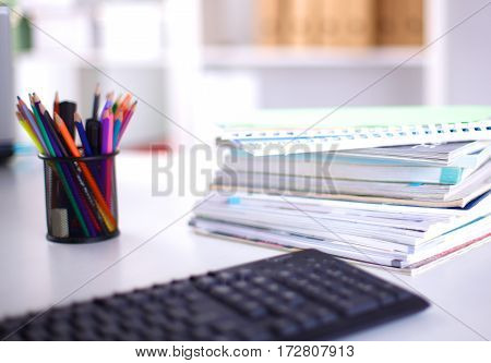 Group of multicolored office folders and glasses.