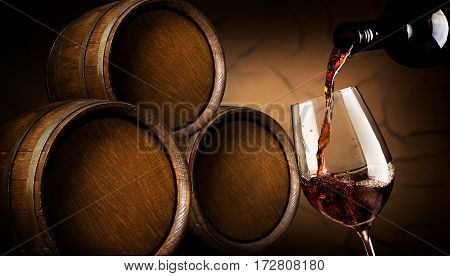 Red wine pouring into wineglass in cellar