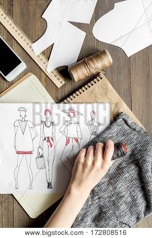 desktop designer clothes with tools top view mock up at wooden table