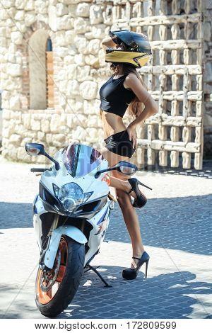 Pretty Girl Biker In Motorcycle Helmet At Motorbike Or Scooter