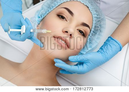 Syringe with filler for face contouring or augmentation. Model, point of view. Cosmetological clinic. Healthcare, cosmetology, clinic
